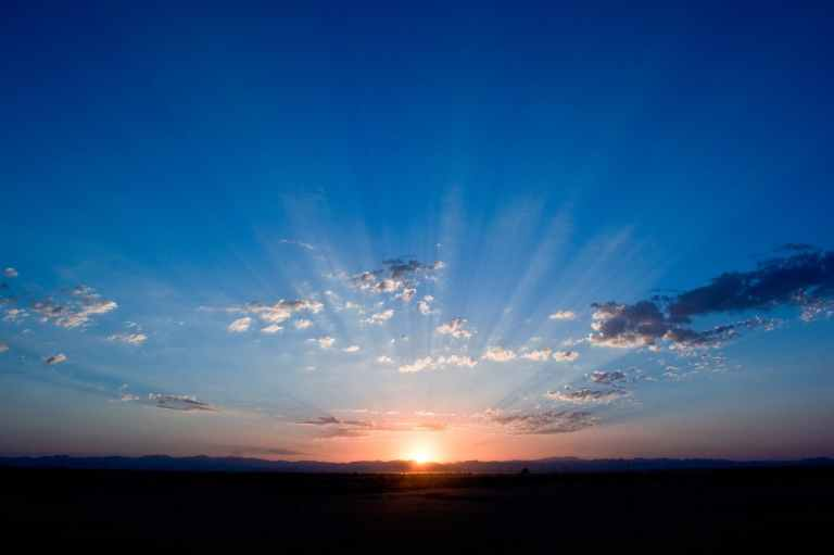 sunrise under cloudy sky illustration