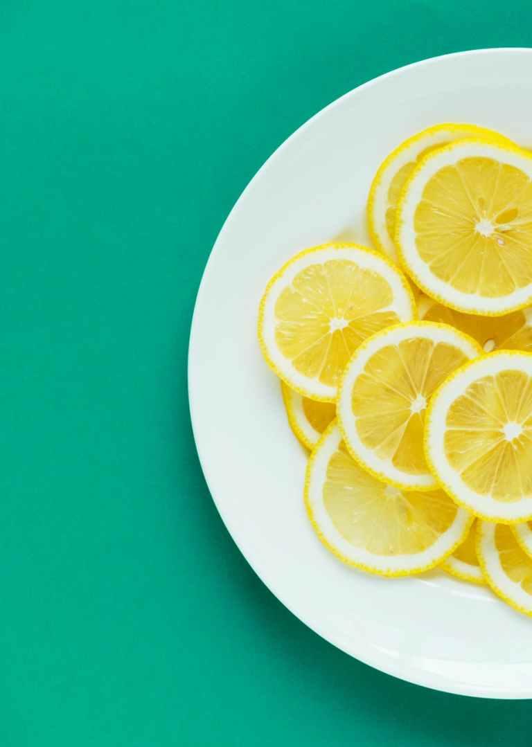slices of lemon on white plate